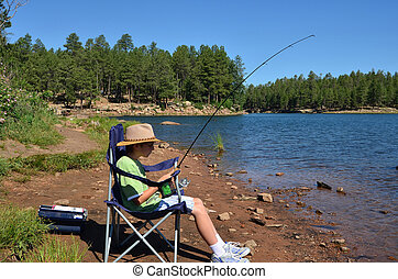 Fishing Boy - Young boy fishing and resting in a chair