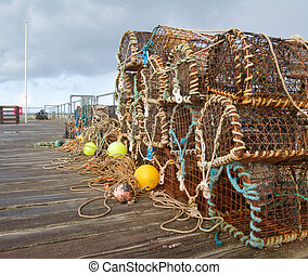 lobster pots - a selection of lobster pots on a boardwalk