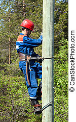 Electrician on a pole - Electrician working at height on a...