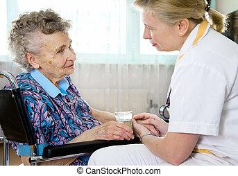 Nursing home - Senior woman with her home caregiver.