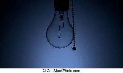 Light bulb being switched on