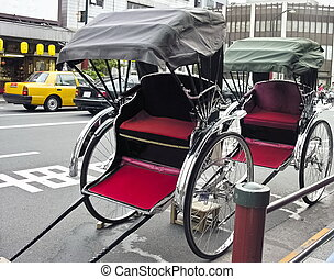 Rickshaw in urban style - Two Rickshaw parked in urban...