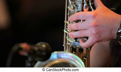 Saxophone - The man enjoys playing the saxophone.