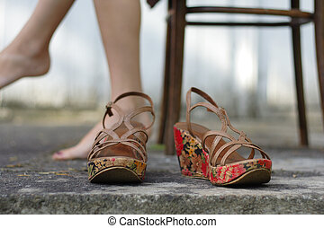 Womens shoes on the pavement - With legs silhouette in the...
