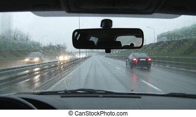 ride in a car in the rain