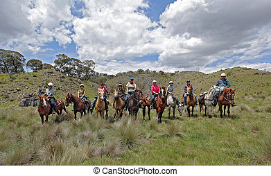 group of riders - group of horse riders having fun in the...