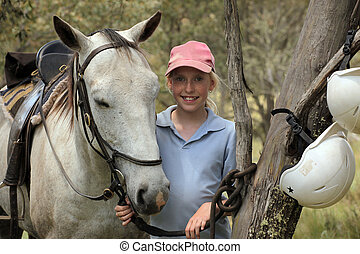 girl rider - young girl rider with a white horse