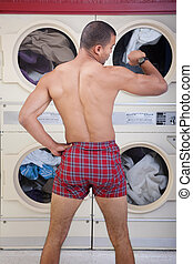 Partially Dressed In the Laundromat - Partially dressed man...