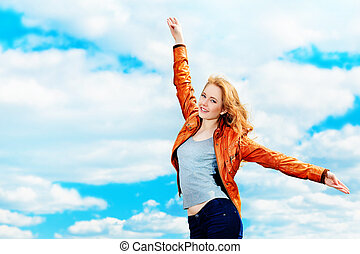 sky - Beautiful young woman outdoors over blue sky.