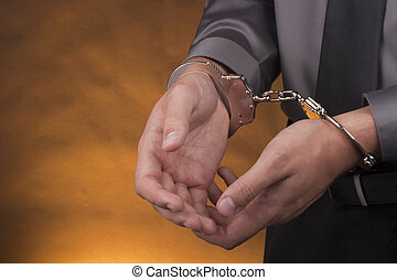 Arrest handcuffs - Arrest, close-up shot man's hands with...