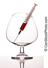 Syringe in wineglass - The syringe with narcotic in empty...