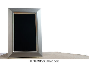 photoframe - silver photoframe on the table in white...