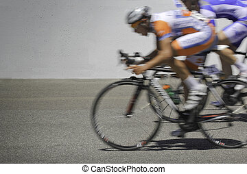 Pack leader - Blurred motion cyclists in a race