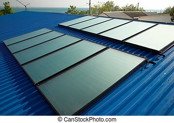 Solar water heating system on the house roof.