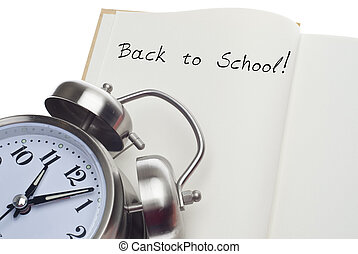 Back to School Time Concept with Alarm Clock and Open Book.