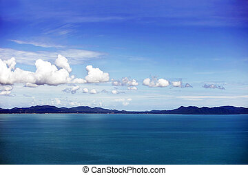 blue seascape with remote mountains on horizon