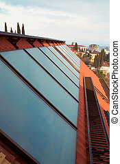 Solar water heating system geliosystem on the red house roof...