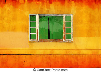 Green window on yellow wall