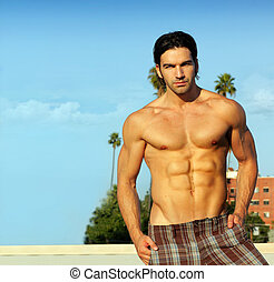 Male model in summer - Portrait of a hunky shirtless male...
