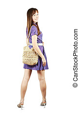 girl with handbag standing on white background