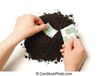 Hand planting Euro banknotes