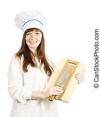 cook holding cutting board and knive - Female cook holding...