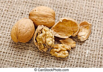 Walnuts on homespun linen background - Whole and cracked...