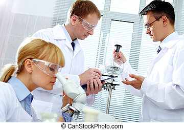 Working clinicians - Two clinicians studying new substance...