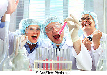 Scientific victory - Portrait of three scientists with...