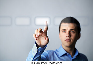 Pushing button - Image of young businessman pressing virtual...