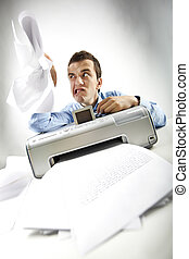 Bad day - Portrait of annoyed businessman holding papers...