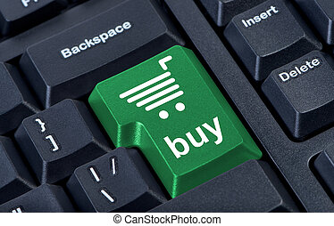 Computer keyboard with green key buy, internet trade concept.