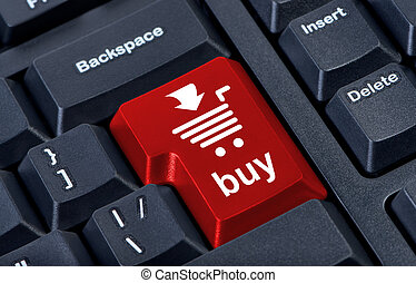 Computer red button buy with cart, internet trade concept.