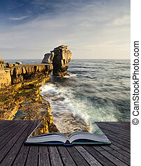 Creative concept image of seascape landscape coming out of pages in magical book