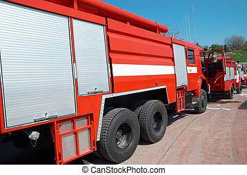 Fire engine - Red fire engine standing on the road