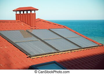 Solar system on the red house roof