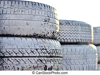 close up of racetrack fence of  white old tires