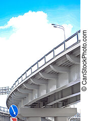 automobile overpass on background of blue sky with clouds. bottom view