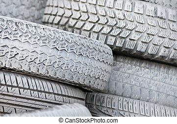 close-up. the white automobile tires dumped in a a big pile