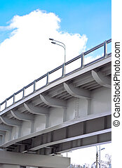 automobile overpass on background of blue sky with clouds...