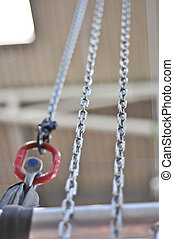 metal chain and a red mounting bracket