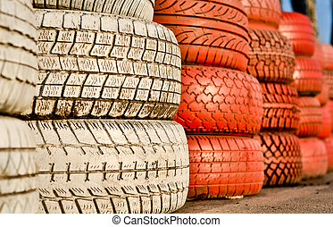 close up of racetrack fence of white and red of old tires