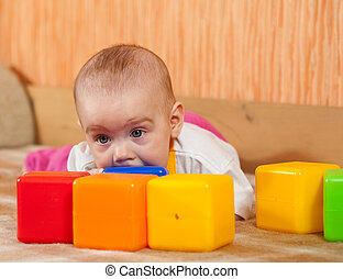 Baby plays with toy blocks - Baby girl plays with toy blocks...