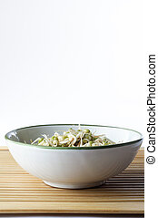 Bowl of Beansprouts on Bamboo - A bowl of mung beansprouts...