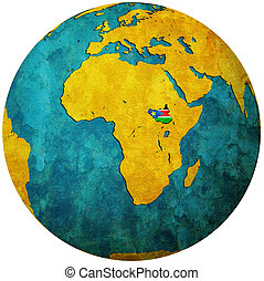 south sudan flag on globe map - south sudan territory with...