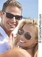 Happy Attractive Woman and Man Couple In Sunglasses At Beach...