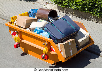 Bulky items and old garbage in  a container