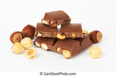 Chocolate pieces with nut, isolated on white background