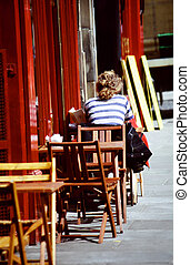 Outdoor cafe - Female tourist having lunch in europe at an...