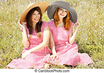 Two girls at contryside. - Two girls at contryside in red...